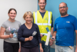 St. Modwen volunteers help decorate library for Locking Primary school